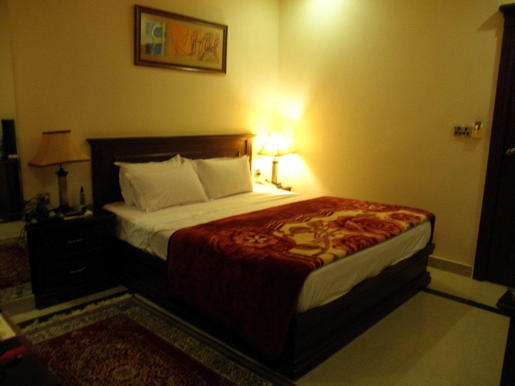 Raj One Hotel